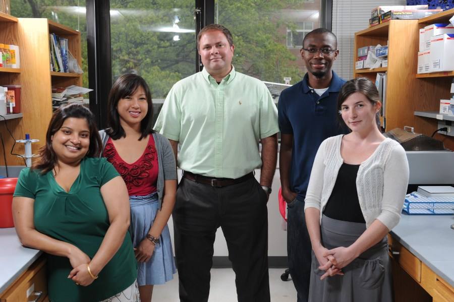 Jerod Denton, PhD, center, and his research staff are developing small-molecule probes for members of the inward rectifier family of potassium (Kir) channels.