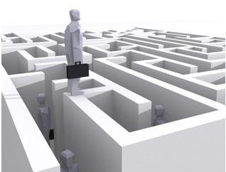 Man with briefcase standing on a maze