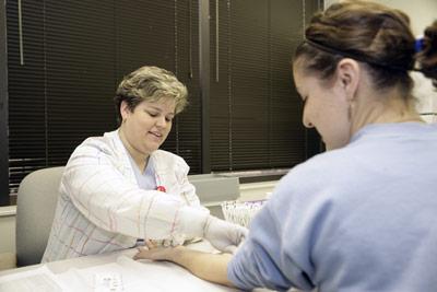 patient having blood drawn