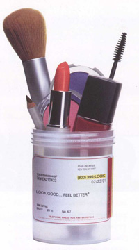 lipstick, blush, macara and makup in a prescription bottle