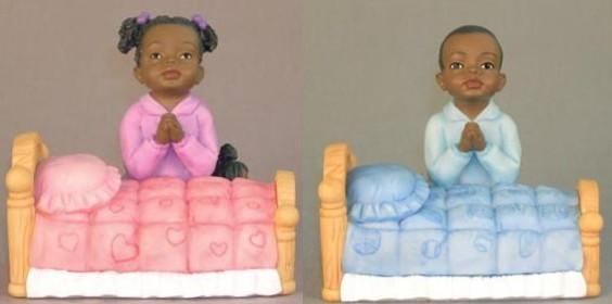 children praying figurines