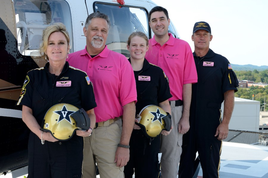 Photo Cutline: (left to right) Marsha Roberts, RN, EMT-IV, flight nurse; Randy Hughes, EMT-P, flight communications; Leah Smith, RN, EMT, flight nurse; Kevin Mobley, EMT-IV; flight communications and Bric Baker, pilot, are all showing the pink flight name badges and pink shirts that LifeFlight staff will wear during the month of October. Photo by David Russell.