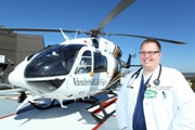 Jeremy Brywczynski, M.D. standing next to a LifeFlight Helicopter