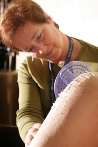 Doctor examining patient's shoulder